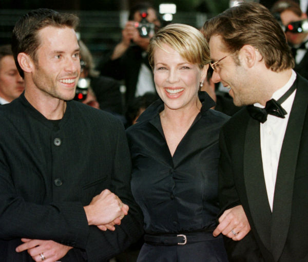 Kim Basinger arrives with Australian actors Guy Pearce, left, and Russell Crowe for the screening of Curtis Hanson's film 'L.A Confidential,' in competition for the Cannes Film Festival on May 14, 1997.