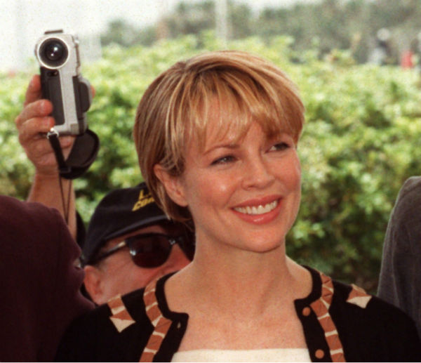 Danny De Vito, hidden behind actress Kim Basinger, films press photographers with a small digital camera during the presentation of &#39;L.A. Confidential,&#39; directed by Curtis Hanson in competition for the Cannes, France Film Festival on May 14, 1997. <span class=meta>(AP Photo &#47; Laurent Rebours)</span>