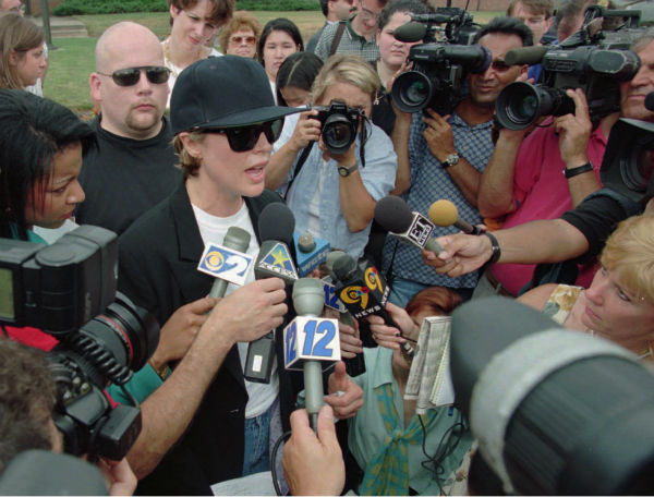 Actress Kim Basinger, center, is mobbed by the news media as she leaves Huntingdon Life Sciences in East Millstone, N.J. on July 3, 1997. Basinger went to the research laboratory with members of People for the Ethical Treatment of Animals to claim 36 beagles spared from drug research that would have involved breaking the dogs&#39; legs. Huntingdon did not turn the dogs over to her, saying in a statement that the dogs were bred for research, and that they are not pets. <span class=meta>(AP Photo &#47; Daniel Hulshizer)</span>