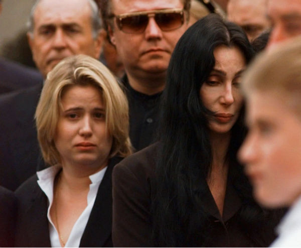 Chastity Bono left, and Cher exit St. Theresa...