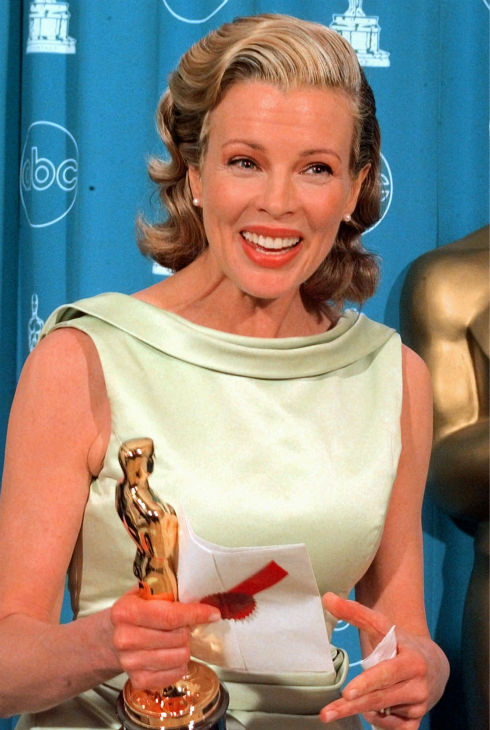 Kim Basinger holds the envelope and the Oscar after winning Best Supporting Actress for 'L.A. Confidential' at the 70th Academy Awards at the Shrine Auditorium in Los Angeles on March 23, 1998.