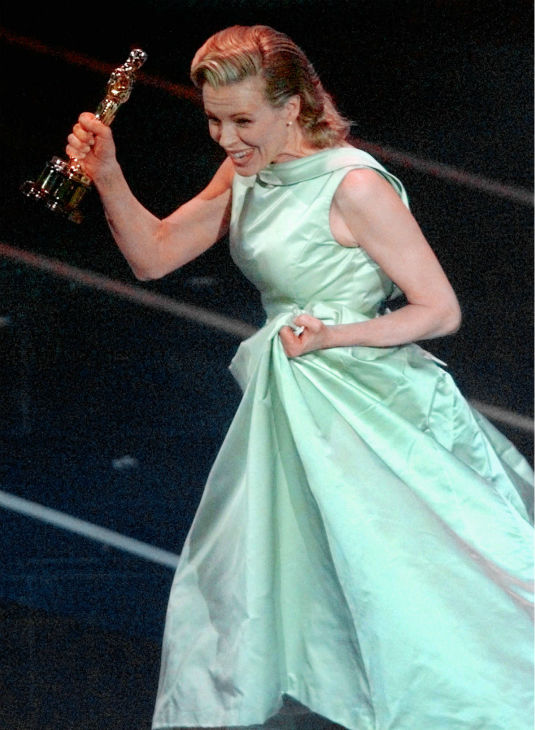 Kim Basinger mouths to her husband, Alec Baldwin, 'I can't believe it,' after receiving the Best Supporting Actress Oscar for her role in 'L.A. Confidential' at the 70th Academy Awards in Los Angeles on March 23, 1998.