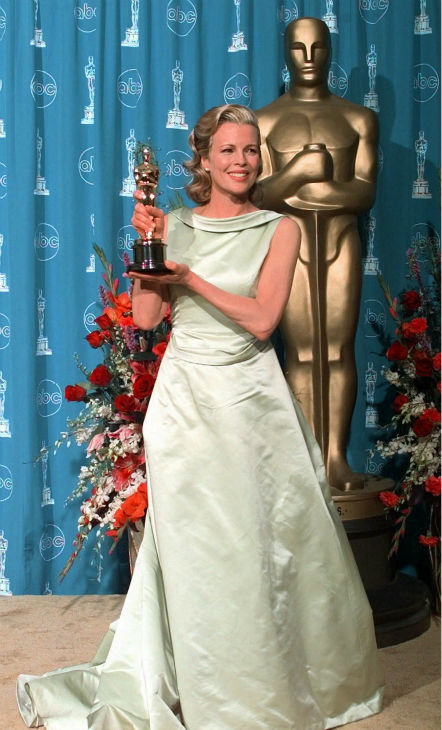Kim Basinger holds the Oscar she just won for Best Supporting Actress for 'L.A. Confidential,' at the 70th Academy Awards at the Shrine Auditorium in Los Angeles on March 23, 1998.