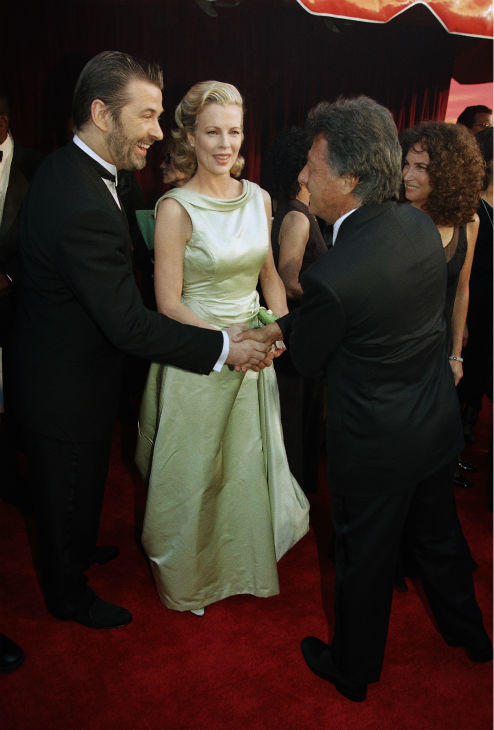 "<div class=""meta ""><span class=""caption-text "">Actress Kim Basinger and husband actor Alec Baldwin, left, greet Oscar nominated actor Dustin Hoffman as they arrive for the 70th Academy Awards show on March 23, 1998 in Los Angeles. Basinger won an Oscar in the category for best performance by an actress in a supporting role for her part in 'L.A. Confidential.' (AP Photo / Chris Pizzello)</span></div>"