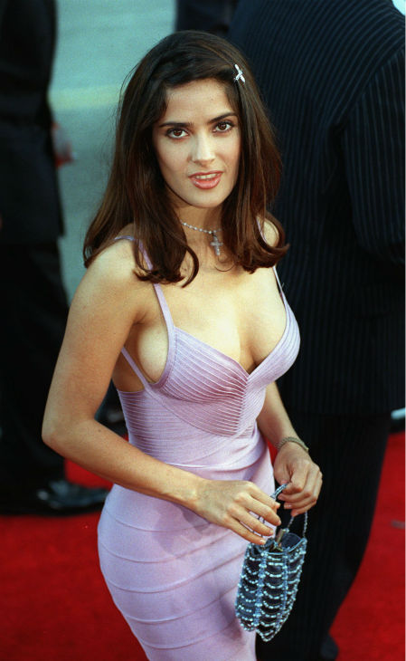 Salma Hayek poses for photographers after arriving as a guest at the premiere of the new film 'Lethal Weapon 4' outside the Mann's Chinese Theatre in the Hollywood section of Los Angeles on July 7, 1998.