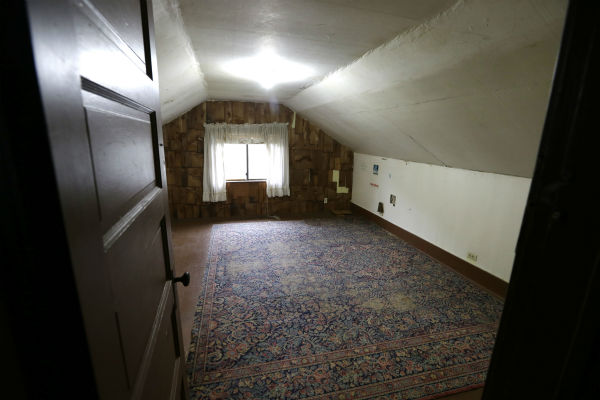 In this photo taken on Sept. 23, 2013, an attic bedroom used by Kurt Cobain, the late frontman of Nirvana, is said by realtors to still include the original rug from when he lived in his childhood home in Aberdeen, Washington.