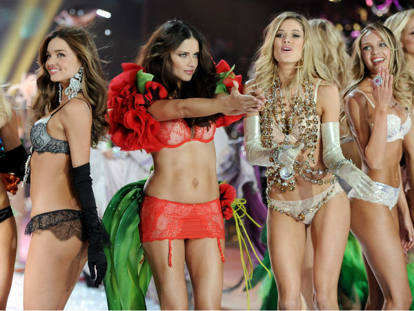 Models, from left, Miranda Kerr, Adriana Lima, Doutzen Kroes and Candice Swanepoel walk the runway during the finale of the 2012 Victoria&#39;s Secret Fashion Show on Wednesday, Nov. 7, 2012 in New York. <span class=meta>(AP Photo &#47; Invision &#47; Evan Agostini)</span>