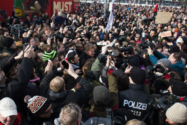 David Hasselhoff, center, arrives for a protest against the removal of a section of the East Side Gallery, a historic part of former Berlin Wall, in Berlin on Sunday, March 17, 2013. Hasselhoff is fondly remembered by many Germans for releasing a song called &#39;Looking for Freedom&#39; shortly before the fall of the Wall in 1989. <span class=meta>(AP Photo &#47; Markus Schreiber)</span>