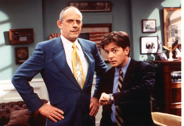 "<div class=""meta ""><span class=""caption-text "">Actors Christopher Lloyd, left, and Michael J. Fox are shown in this undated photo on the set of ABC's 'Spin City' during the taping of an episode entitled, 'Back to the Future IV-Judgement Day.'  The episode reunites Fox, who starred in the 'Back to the Future' movie series, and Lloyd, who plays Fox's former political mentor.   (ABC, Eric Liebowitz)</span></div>"