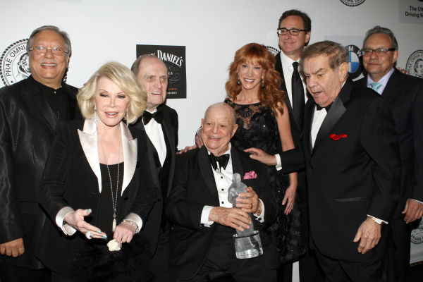 Musician Arturo Sandoval, left, comedienne Joan Rivers, Comedian Bob Newhart, honoree Don RIckles, comedienne Kathy Griffin, Actor Bob Saget, Friars Clubs Dean Freddie Roman and comedian Lewis Black pose for photos at the Friars Club event honoring legendary insult comic Don Rickles, 87, at the Waldorf Astoria in New York on Monday, June 24, 2013. <span class=meta>(Greg Allen &#47; Invision &#47; AP)</span>