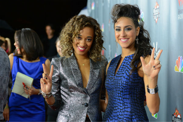 'The Voice' contestants Amanda Brown ('Team Adam') and Sylvia Yacoub ('Team Christina') walk the red carpet before the NBC show's special concert to celebrate the announcement of the top 12, held at the House of Blues in Los Angeles on Nov. 8, 2012.