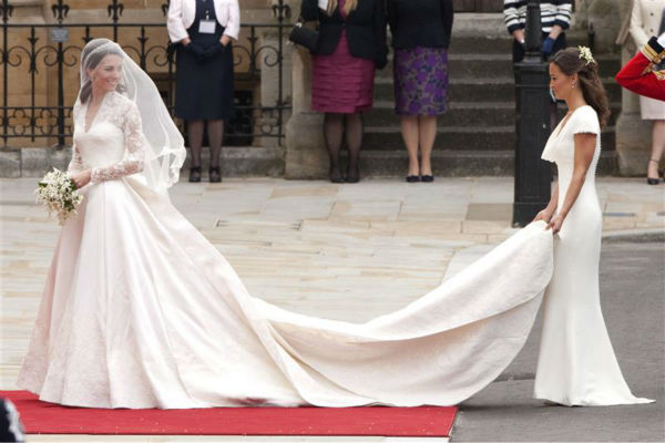 "<div class=""meta image-caption""><div class=""origin-logo origin-image ""><span></span></div><span class=""caption-text"">Pippa Middleton holds her sister Kate Middleton's train at her Royal Wedding to Prince William at Westminster Abbey in London on April 29, 2011. Pippa became famous due to her a cowl-neck, body-hugging, ivory bridesmaid gown by Sarah Burton at Alexander McQueen. (Guido Ohlenboste / Startraksphoto.com)</span></div>"