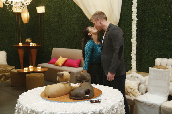 &#39;The Bachelor&#39; season 17 star Sean Lowe and Catherine Giudici kiss in front of their Groom&#39;s Cake, a tribute to their dogs, before their wedding, which aired live on TV as part of ABC&#39;s &#39;The Bachelor: Sean and Catherine&#39;s Wedding&#39; special on Jan. 26, 2014. <span class=meta>(ABC Photo &#47; Greg Zabilski)</span>