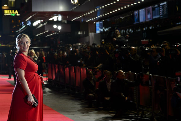 "<div class=""meta image-caption""><div class=""origin-logo origin-image ""><span></span></div><span class=""caption-text"">Kate Winslet walks the red carpet at the premiere of 'Labor Day' in London on Oct. 14, 2013. She and husband Ned Rocknroll are expecting their first child together -- and her third overall. (Ben Pruchnie for Paramount Pictures International)</span></div>"