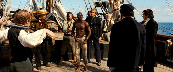 Tom Hanks appears as Dr. Henry Goose and David Gyasi appears as Autua in a scene from the 2012 movie 'Cloud Atlas.'