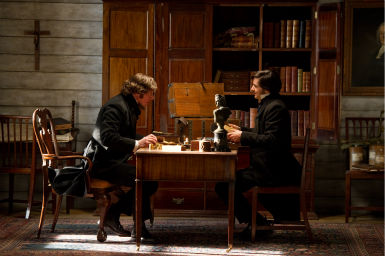 Hugh Grant appears as Reverend Giles Horrox and Jim Sturgess appears as Adam Ewing in a scene from the 2012 movie 'Cloud Atlas.'