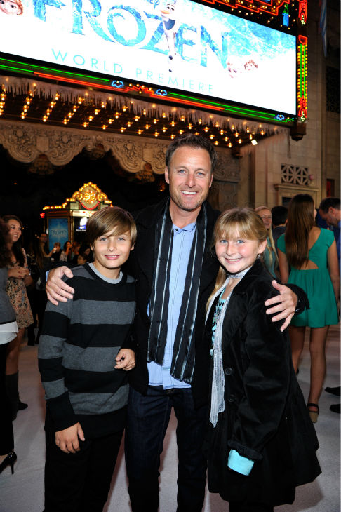 'The Bachelor' host Chris Harrison and his children attend the premiere of Disney's 'Frozen' at the El Capitan Theatre in Los Angeles on Nov. 19, 2013.