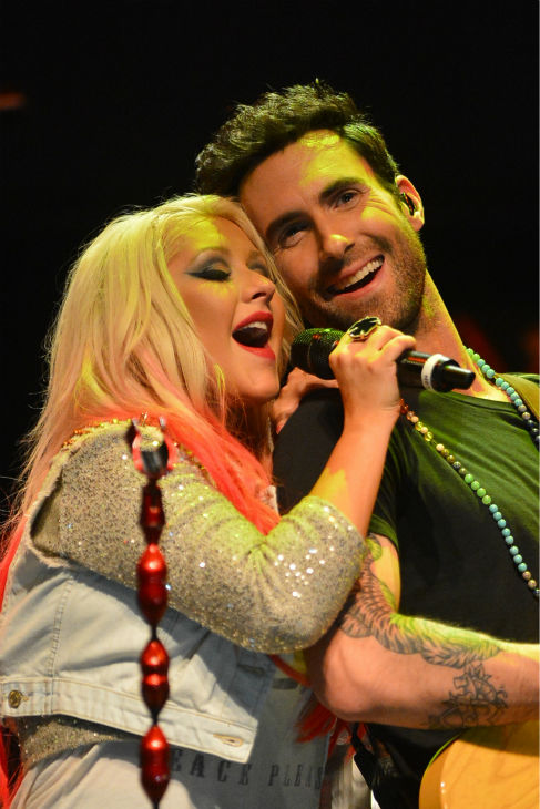 'The Voice' coaches Christina Aguilera and Adam Levine perform at the NBC show's special concert to celebrate the announcement of the top 12, held at the House of Blues in Los Angeles on Nov. 8, 2012.