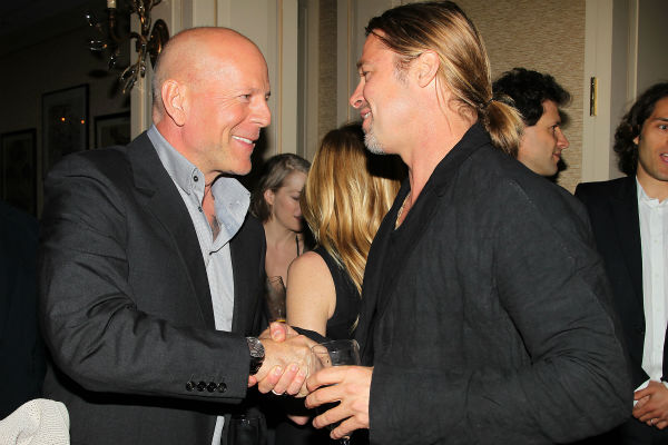 Co-host Brad Pitt and actor Bruce Willis ap