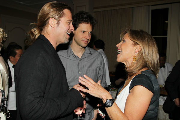 Co-host Brad Pitt and TV host Katie Couric
