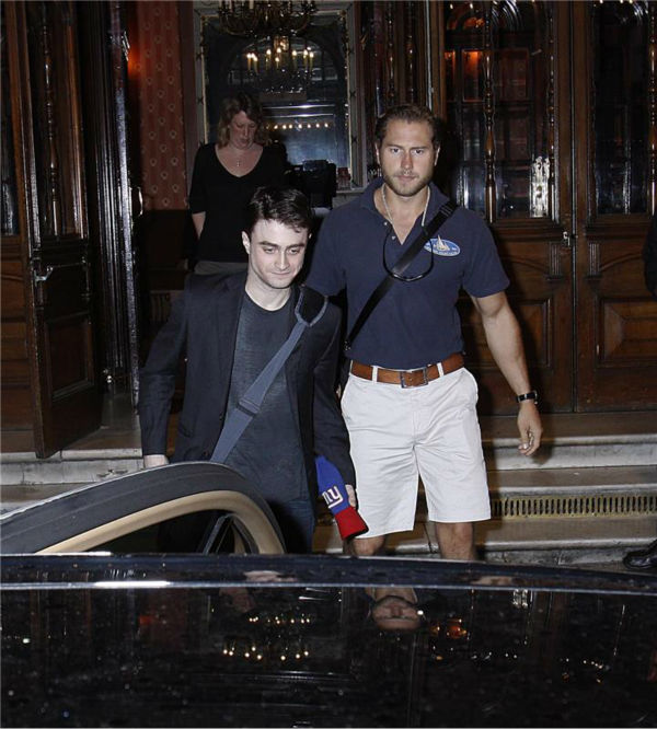 Daniel Radcliffe appears with a bodyguard as fans gather near him in London on Aug. 5, 2013. <span class=meta>(Nikos Vinieratos &#47; REX &#47; Startraksphoto.com)</span>