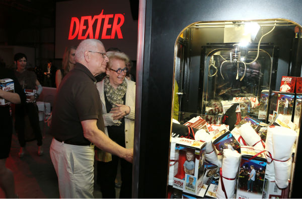 A couple checks out a claw machine with &#39;Dexter&#39; goodies at Showtime&#39;s premiere of &#39;Dexter&#39; season 8 in Los Angeles on June, 15, 2013. <span class=meta>(Eric Charbonneau &#47; Invision for Showtime)</span>