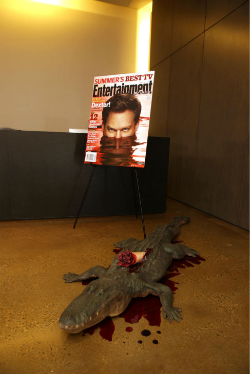 A poster of Michael C. Hall and a fake alligator are seen at Showtime&#39;s premiere of &#39;Dexter&#39; season 8 in Los Angeles on June, 15, 2013. <span class=meta>(Eric Charbonneau &#47; Invision for Showtime)</span>