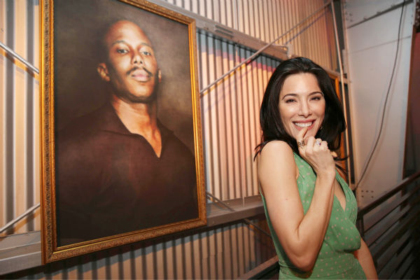 Jaime Murray &#40;Lila, season 2&#41; poses next to a portrait of Doakes &#40;played by Erik King during seasons 1-2&#41; at Showtime&#39;s premiere of &#39;Dexter&#39; season 8 in Los Angeles on June, 15, 2013. <span class=meta>(Eric Charbonneau &#47; Invision for Showtime)</span>