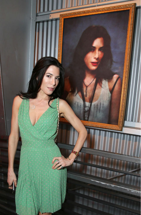 Jaime Murray &#40;Lila, season 2&#41; poses next to a portrait of her character  at Showtime&#39;s premiere of &#39;Dexter&#39; season 8 in Los Angeles on June, 15, 2013. <span class=meta>(Eric Charbonneau &#47; Invision for Showtime)</span>
