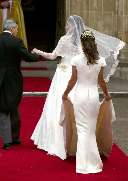 "<div class=""meta image-caption""><div class=""origin-logo origin-image ""><span></span></div><span class=""caption-text"">Pippa Middleton holds her sister Kate Middleton's train at her Royal Wedding to Prince William at Westminster Abbey in London on April 29, 2011. Pippa became famous due to her a cowl-neck, body-hugging, ivory bridesmaid gown by Sarah Burton at Alexander McQueen. (AMH / Startraksphoto.com)</span></div>"