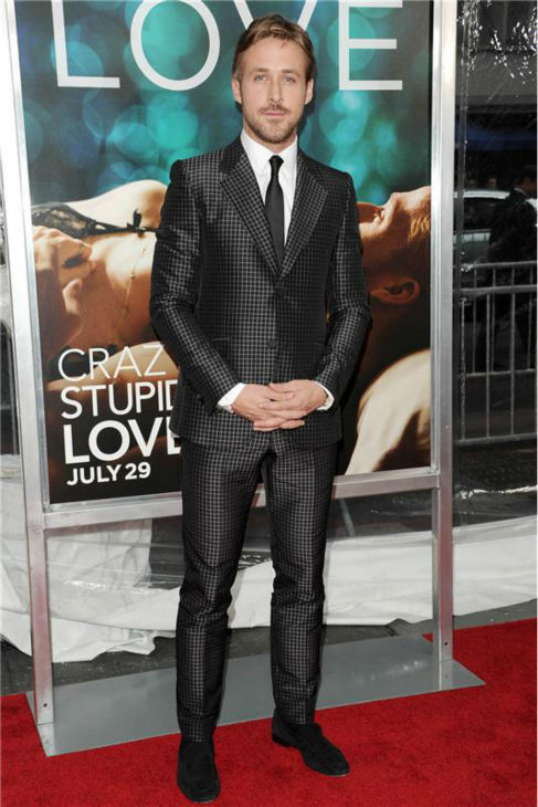 The 'Check-Out-My-Suit' stare: Ryan Gosling appears at the premiere of 'Crazy Stupid Love' in New York on July 19, 2011.