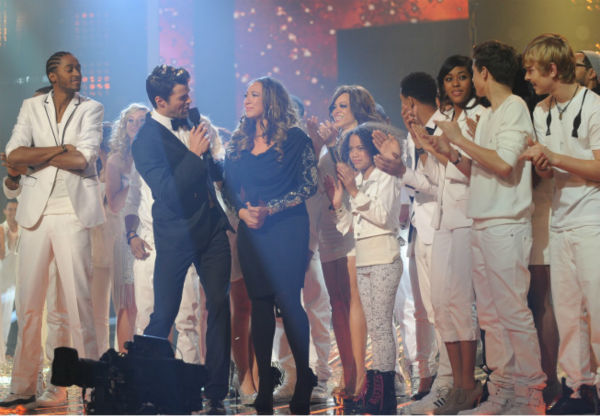 Melanie Amaro is surrounded by former contestants and host Steve Jones after she is announced the winner of the FOX show 'The X Factor' on Dec. 22, 2011.