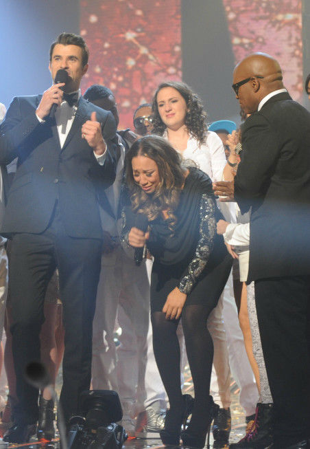 Melanie Amaro is surrounded by former contestants, as well as host Steve Jones (L) and co-judge L.A. Reid, after she is announced the winner of the FOX show 'The X Factor' on Dec. 22, 2011.