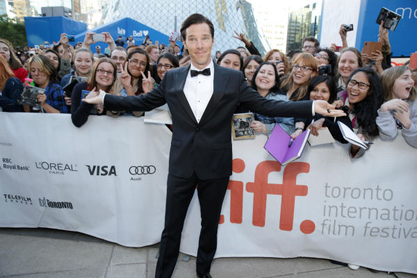 "<div class=""meta ""><span class=""caption-text "">Benedict Cumberbatch poses with fans at the premiere of his new film 'The Fifth Estate,' in which he plays WikiLeaks founder Julian Assange, at the 2013 Toronto International Film Festival in Toronto on Sept. 5, 2013. (Eric Charbonneau / Invision for DreamWorks Pictures / AP Images)</span></div>"