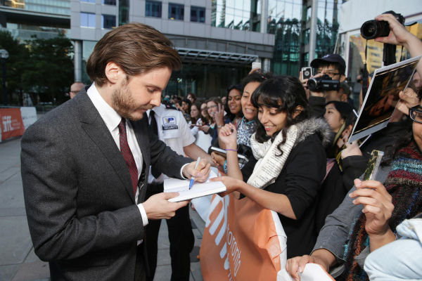 "<div class=""meta image-caption""><div class=""origin-logo origin-image ""><span></span></div><span class=""caption-text"">Cast member Daniel Bruhl appears with fans at the premiere of 'The Fifth Estate' at the 2013 Toronto International Film Festival in Toronto on Sept. 5, 2013. (Eric Charbonneau / Invision for DreamWorks Pictures / AP Images)</span></div>"