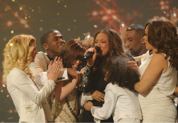 "<div class=""meta image-caption""><div class=""origin-logo origin-image ""><span></span></div><span class=""caption-text"">Melanie Amaro is surrounded by former contestants after she is announced the winner of the FOX show 'The X Factor' on Dec. 22, 2011. (Ray Mickshaw / FOX)</span></div>"