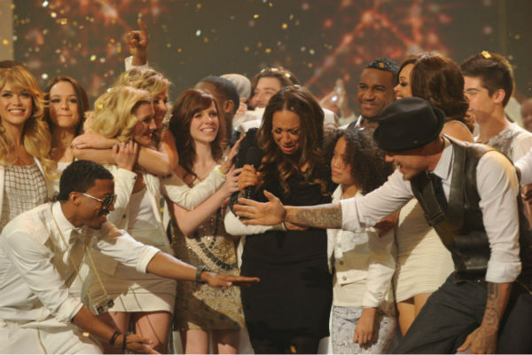 Melanie Amaro is surrounded by former contestants after she is announced the winner of the FOX show 'The X Factor' on Dec. 22, 2011.