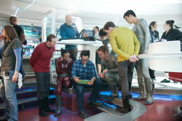 L-R: Simon Pegg &#40;Scotty&#41;, Zoe Saldana &#40;Uhura&#41;, director J.J. Abrams, Chris Pine &#40;Kirk&#41;, Karl Urban &#40;Bones&#41;, Anton Yelchin &#40;Chekov&#41; and John Cho &#40;Sulu&#41; appear on the set of the 2013 film &#39;Star Trek Into Darkness.&#39; <span class=meta>(Zade Rosenthal &#47; Paramount Pictures)</span>