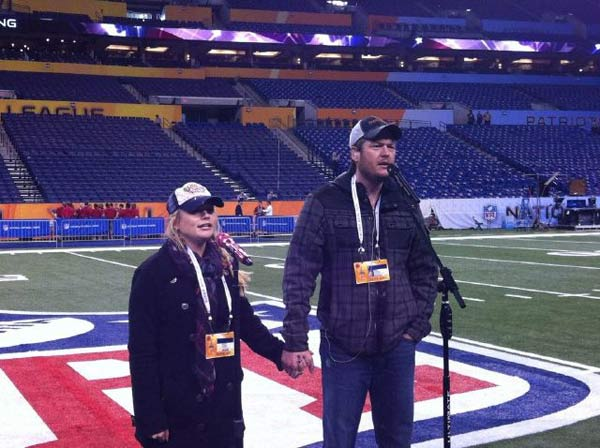 Miranda Lambert Tweeted a photo of her and Blake Shelton on the field and wrote, &#39;Super Bowl!!!!&#39; The married couple will perform &#39;America the Beautiful&#39; before the game.  &#40;Pictured: Miranda Lambert and Blake Shelton in a Twitter photo posted by Lambert.&#41; <span class=meta>(Twitter)</span>