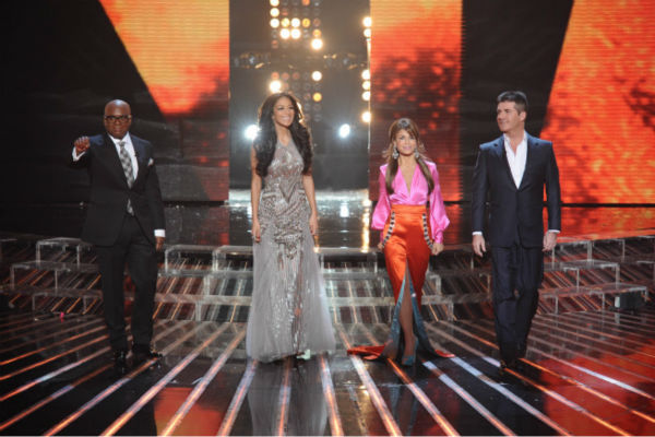 "<div class=""meta image-caption""><div class=""origin-logo origin-image ""><span></span></div><span class=""caption-text"">L-R: Co-judges L.A. Reid, Nicole Scherzinger, Paula Abdul and Simon Cowell appear on stage on 'The X Factor' finale on Dec. 22, 2011. Scherzinger is wearing a sparkling smoke and silver beaded column Pamella Roland gown with silk tulle godets from the designer's Fall/Winter 2011 collection. Abdul is wearing a pink and orange Louis Verdad gown with teal pumps. (Michael Becker / FOX)</span></div>"