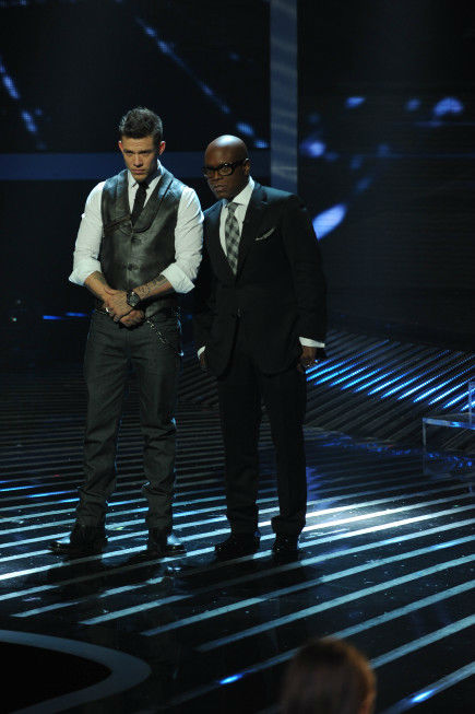 Chris Rene (L) and his mentor, co-judge L.A. Reid (R), appear on stage on 'The X Factor' finale on Dec. 22, 2011.