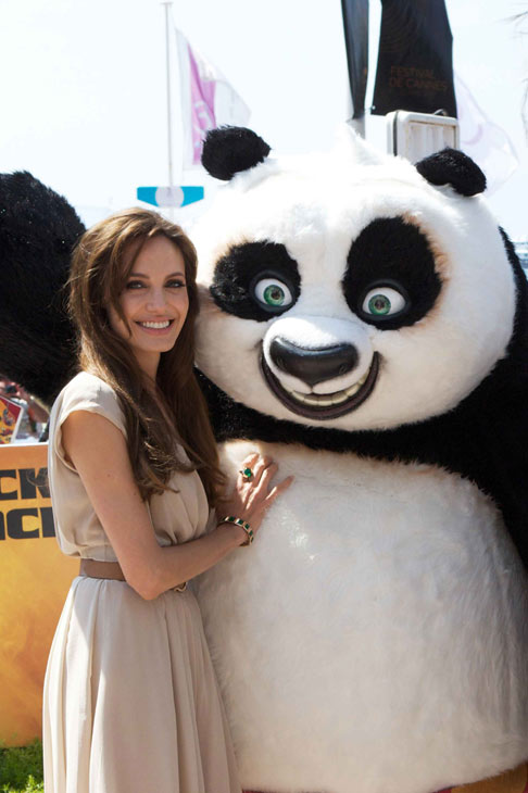 Angelina Jolie dazzles the crowds at a May 12 photo call in Cannes, France to celebrate DreamWorks Animation&#39;s &#39;Kung Fu Panda 2,&#39; which will be released by Paramount Pictures on Thursday, May 26, 2011. The actress is wearing a beige, V-neck Salvatore Ferragamo wrap mini-dress. <span class=meta>(Lucian Capellaro &#47; Paramount)</span>