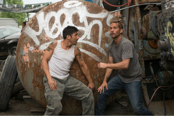 David Belle and Paul Walker appear in a scene from the 2014 action movie &#39;Brick Mansions.&#39; Walker plays an undercover cop. The film is set in Detroit in 2018. Brick Mansions is a government-quarantined housing project that is home to criminals. Belle plays one of its residents, Lino. The actor also starred in the French film &#39;District B13,&#39; on which &#39;Brick Mansions&#39; is based. <span class=meta>(Philippe Bosse &#47; Relativity Media &#47; EuropaCorp &#47;Transfilm International Inc.)</span>