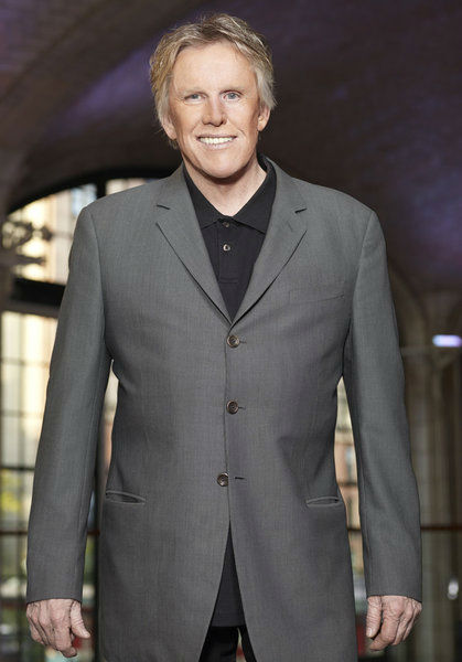Gary Busey appears in an official publicity...