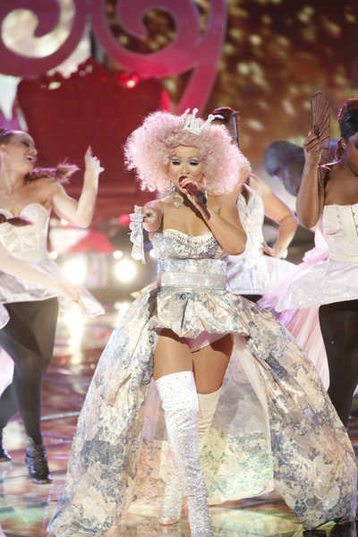 Christina Aguilera performs her new single 'Make The World Move' with fellow show mentor Cee Lo Green on the NBC show 'The Voice' on Nov. 13, 2012.