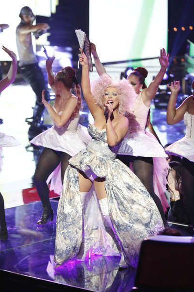 "<div class=""meta ""><span class=""caption-text "">Christina Aguilera performs her new single 'Make The World Move' with fellow show mentor Cee Lo Green on the NBC show 'The Voice' on Nov. 13, 2012. (Tyler Golden / NBC)</span></div>"