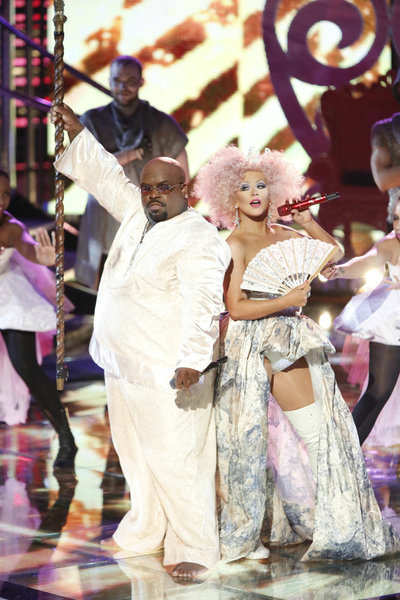 "<div class=""meta image-caption""><div class=""origin-logo origin-image ""><span></span></div><span class=""caption-text"">Christina Aguilera performs her new single 'Make The World Move' with fellow show mentor Cee Lo Green on the NBC show 'The Voice' on Nov. 13, 2012. (Tyler Golden / NBC)</span></div>"