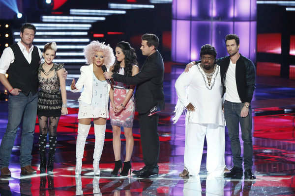 "<div class=""meta ""><span class=""caption-text "">L to R: Blake Shelton, Michaela Paige, Christina Aguilera, Adriana Louise, Carson Daly, CeeLo Green and Adam Levine appear on the NBC show 'The Voice' on Nov. 13, 2012. (Tyler Golden / NBC)</span></div>"