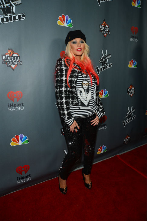 "<div class=""meta ""><span class=""caption-text "">'The Voice' coach Christina Aguilera walks the red carpet before the NBC show's special concert to celebrate the announcement of the top 12, held at the House of Blues in Los Angeles on Nov. 8, 2012. (Frazer Harrison / NBC)</span></div>"