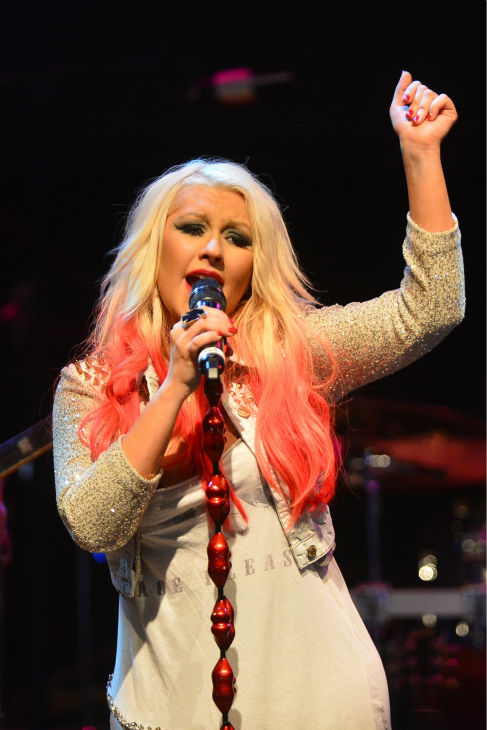'The Voice' coach Christina Aguilera performs at the NBC show's special concert to celebrate the announcement of the top 12, held at the House of Blues in Los Angeles on Nov. 8, 2012.